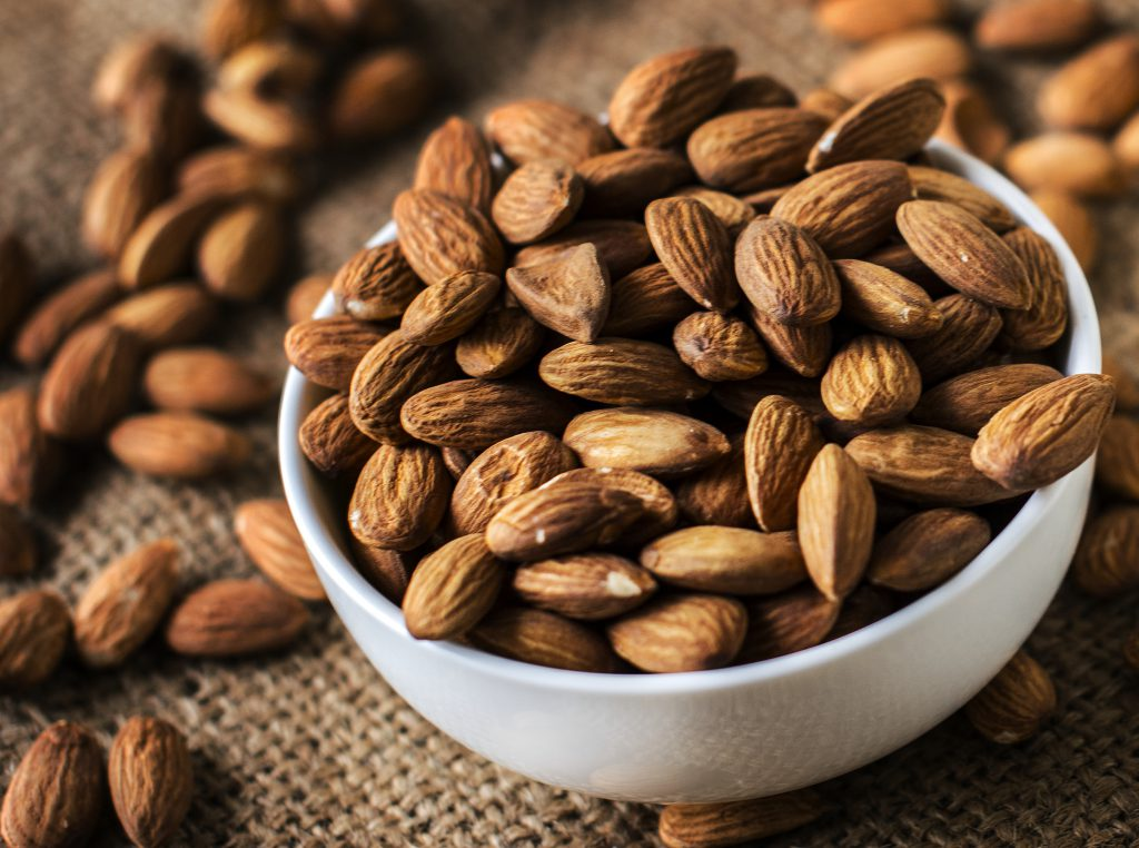 Roasted almonds in a white bowl