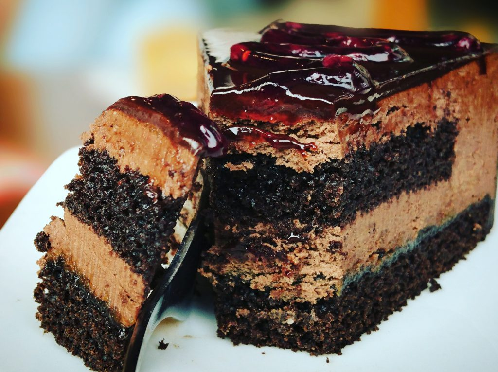 layered chocolate cake with a fruit glaze